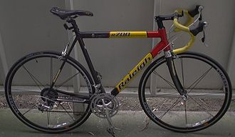Racing bicycle - An aluminum road bicycle made by Raleigh and built using Shimano components.  It uses wheels with a low spoke count for reduced air drag.
