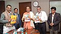 """Radha Mohan Singh along with the Minister of State for Agriculture and Farmers Welfare, Dr. Sanjeev Kumar Balyan releasing an official publication """"Bee World"""", in New Delhi. The Secretary.jpg"""