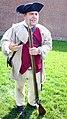 Reenactor with period flintlock musket (18th century).jpg