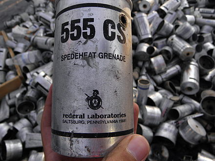 In front an empty US-made tear gas canister Remains of US made tear gas canicters in Bahrain.JPG