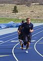 Retired U.S. Navy Hospital Corpsman 2nd Class Max Rohn, a Navy-Coast Guard team member, practices the baton relay during track and field practice in preparation for the 2013 Warrior Games in Colorado Springs 130510-N-DT940-066.jpg