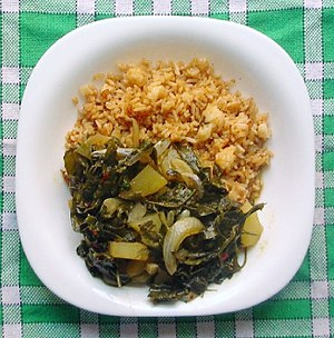 Curry - Rice and Chenopodium album leaf curry with onions and potatoes; a vegetarian curry