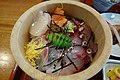 Rice bowl topped with sashimi combo (13807801983).jpg