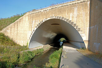 River Bollin - The River Bollin flows beneath the southern runway of Manchester Airport in this tunnel
