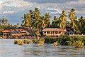 River bank of Don Khon with stilt wooden houses at golden hour from Don Det Laos.jpg