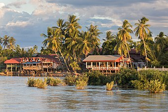 River bank of Don Khon with stilt wooden houses at golden hour from Don Det Laos.jpg