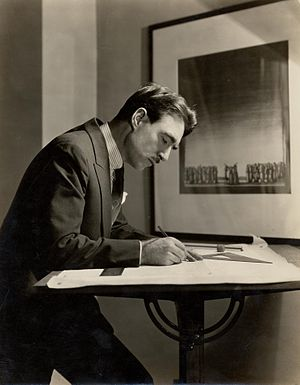 Lighting designer - Light designer Robert Edmond Jones (1887-1954) drawing at a waist high table (c. 1920).
