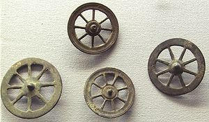 Taranis - Votive wheels called Rouelles, thought to correspond to the cult of Taranis. Thousands of such wheels have been found in sanctuaries in Belgic Gaul, dating from 50 BC to 50 AD. Musée d'Archéologie Nationale.