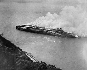 SS Rex - Rex, capsized and burning after the RAF attack.