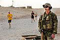 Royal Australian Air Force Leading Aircraftman Matt Nissen, right, provides security during the Sand to Sand charity run at Multinational Base Tarin Kowt, Uruzgan province, Afghanistan, Aug. 17, 2013 130817-O-MD709-228-AU.jpg