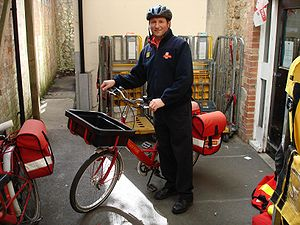 English: Royal mail bicycle messenger in Ilmin...