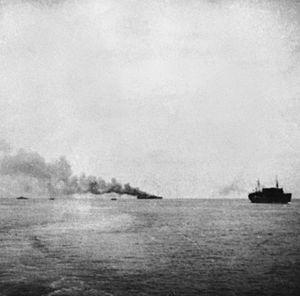 18th Infantry Division (United Kingdom) - The Empress of Asia, burning following the attack by Japanese aircraft.