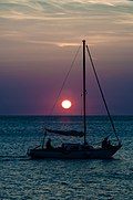 Sailing boat and sunset, Greece.jpg