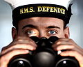 Sailor with Binoculars on HMS Defender MOD 45156486.jpg