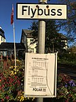 Sign and time table at bus stop for Polar Tours Flybussen (airport shuttle bus) by Scandic Meyergården hotel, Fridtjof Nansens gate, Mo i Rana, Norway - 2017-10-09.jpg