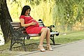 Sitting pregnant woman in red.jpg