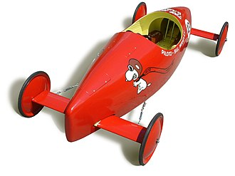 "Soap Box Derby - An official Soap Box Derby racer from 1967, including a ""Snoopy as the flying ace"" picture."