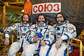 Soyuz TMA-06M crew in front of their spacecraft.jpg