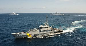 Dutch Caribbean Coast Guard - The Dutch Caribbean Coast Guard cutter Jaguar with two Holland-class offshore patrol vessels in the background