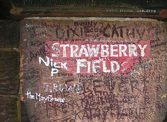 "Strawberry Fields Forever - Heavily graffiti-ed gatepost sign at Strawberry Field – with the word ""Forever"" added in acknowledgement of the Beatles song"