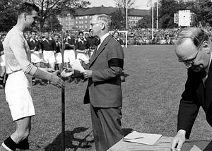 Malmö IP - Sture Mårtensson (left) of Malmö FF receives his gold medal at Malmö IP at the end of the 1944 season, when the club first won the Swedish championship