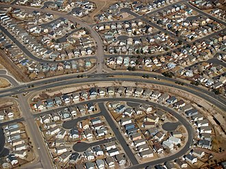 A suburban neighborhood of tract housing within the city of Colorado Springs, Colorado, United States; cul-de-sacs are hallmarks of suburban planning. Suburbia by David Shankbone.jpg