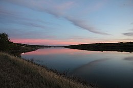 Sunset on Des Lacs Lake (6260731032).jpg