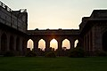 Sunset through the arches (5102931551).jpg