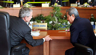 Surayud Chulanont - Surayud (right) with George W. Bush at the National Conference Center in Hanoi