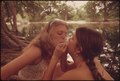 TWO GIRLS SMOKING POT DURING AN OUTING IN CEDAR WOODS NEAR LEAKEY, TEXAS. (TAKEN WITH PERMISSION). ONE OF NINE... - NARA - 554908.tif
