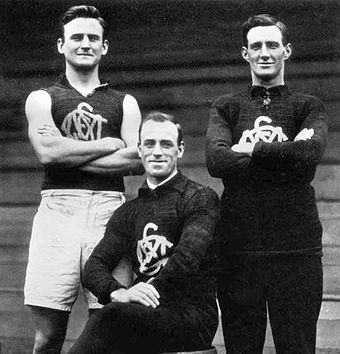 "South Melbourne's renowned ruck combination of the 1920s, left to right: Mark Tandy, Fred Fleiter and Roy Cazaly. Fleiter coined the phrase ""Up there, Cazaly!"" as a signal that he had cleared the way for Cazaly to leap for the ball. It was used as a battle cry by Australian soldiers during World War II, and inspired Mike Brady's 1979 Australian football anthem of the same name. Tandy Fleiter Cazaly.jpg"
