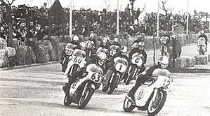 Mike Hailwood - Hailwood (63) and Agostini (1) in the 1969 500 cc race at Riccione street circuit, part of the Temporada Romagnola Italian series of street-races