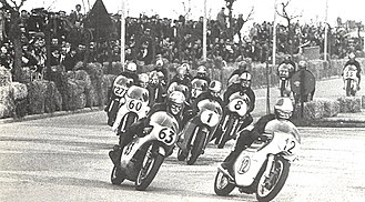 Giacomo Agostini - Mike Hailwood (63) and Agostini (1) in the 1969 500 cc race at Riccione street circuit, part of the Temporada Romagnola Italian series of street-races