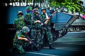 Thai soldiers and Type 85 APCs during 2010 Thai political protests.jpg