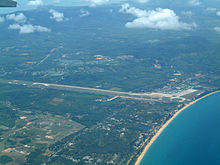 Aerial view of Phuket International Airport terminal building and runway