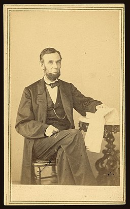 The Library of Congress - (Abraham Lincoln, U.S. President. Seated portrait, holding glasses and newspaper, Aug. 9, 1863) (LOC)