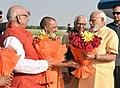 The Prime Minister, Shri Narendra Modi being welcomed by the Governor of Uttar Pradesh, Shri Ram Naik and the Chief Minister, Uttar Pradesh, Yogi Adityanath, on his arrival, at Lucknow, in Uttar Pradesh on June 20, 2017 (1).jpg