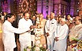 The Vice President, Shri M. Venkaiah Naidu lighting the lamp to inaugurate the World Telugu Conference, in Hyderabad.jpg