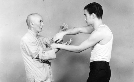 Bruce Lee and his teacher Ip Man. The age of 18 Bruce Lee and Ye Wen.jpg
