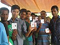 The young voters displaying their voter identity card, at a polling booth during the 4th Phase of Lok Sabha General Elections-2014, in Tripura on April 12, 2014.jpg