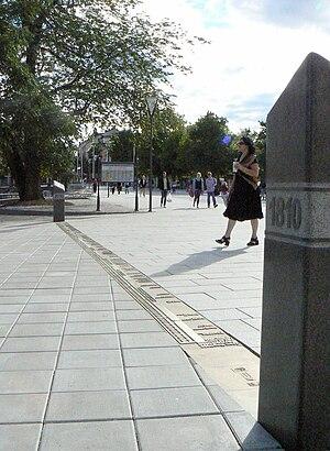 "Timeline - The bronze timeline ""Fifteen meters of History"" with background information board, Örebro, Sweden."