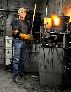 Damascus steel - A bladesmith forging a Damascus blade