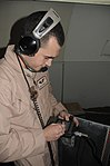Tinker Senior Airman Performs a Systems Check on a Deployed Air Mission DVIDS256879.jpg