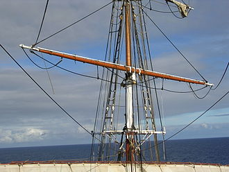 """Yard (sailing) - A view of Stavros S Niarchos's main-topgallant yard shortly after maintenance, clearly showing its various parts. On relatively """"modern"""" late-nineteenth-century rigs like this, the quarters make up almost all of it. Click the picture for more details."""