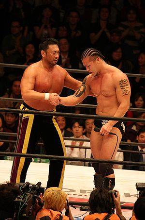 Toshiaki Kawada - Kawada (left) shaking hands with Zeus following a match in 2008.