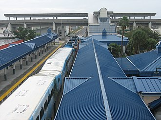 Tri-Rail and Metrorail Transfer station - View of entire station, with the Tri-Rail station foreground and the Metrorail line elevated in background