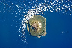 British Overseas Territories - Tristan da Cunha on 6 February 2013, as seen from space. The population was temporarily evacuated to the UK in 1961 because of an eruption. Postal code TDCU 1ZZ