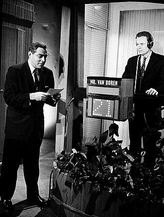 Charles Van Doren - Van Doren in the isolation booth on the quiz show Twenty-One, with host Jack Barry (1957)