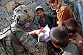 U.S. Army Capt. Louis M. Cascino, left, with Echo Company, 2nd Battalion, 506th Infantry Regiment, 4th Brigade Combat Team, 101st Airborne Division, looks through a book that an Afghan child showed him while on 130602-A-DQ133-232.jpg
