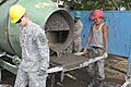 U.S. Army Sgt. Sean M. Belka, left, with the 176th Engineer Company, 96th Troop Command, Washington Army National Guard, and Mongolian Armed Forces Pvt. Sandagochir Erdeneoctir, with a construction 130726-M-DR618-079.jpg